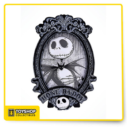 """Show of your expressive side with this delightful Tim Burton's Nightmare Before Christmas Jack Skellington Bone frame. With Jack Skellington in bas relief, this frame is sure to keep your memories safe.   Jack Skellington """"Bone Daddy"""" Frame Approx. 1'' L x 5'' W x 7 1/2'' H Resin"""