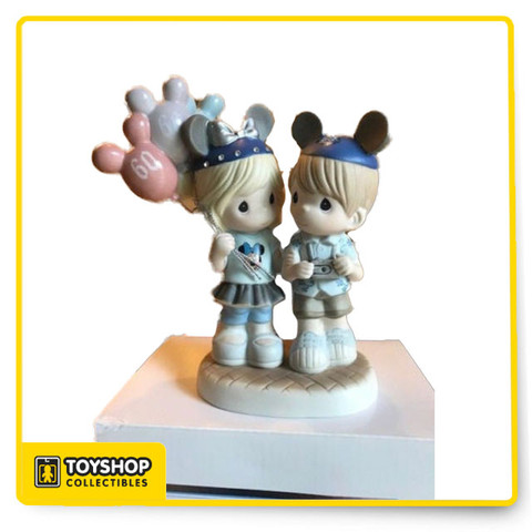 """Share the Gift of Love"" Collection only at Disneyland Parks.   Artist: Hiko Maeda. Authentic Disney Park Item.  Very Detailed Piece.  Approx 6.5"" Tall. Great Disney 60th Diamond Celebration Keepsake."