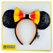 Magic in the details Created especially for Walt Disney World Resort and Disneyland Resort Glitter candy corn colored bow Sequined, padded ears and headband Orange velour interior band The bare necessities All man-made materials 8'' H x 11'' W