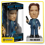This X-Files Fox Mulder Bobble Head stands about 6-inches tall atop his name display base. Featuring the likeness of actor David Duchovny, this bobble head comes in a window display box. Fox Mulder is pictured in his black suit with a gun in his right hand and his F.B.I.. badge on his left chest. Trust no one, but do pick up this Fox Mulder bobble head! Ages 14 and up.