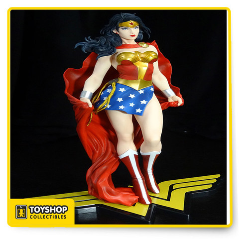 """ WONDER WOMAN"" The Amazon warrior has never looked more regal and powerful than in this new look as envisioned by superstar artist Jim Lee.  Diana wears her iconic outfit featuring the red and gold bodice with eagle motif, gold belt, blue skirt with white stars and tall red and white boots. Meanwhile, no version of Wonder Woman would be complete without her star-studded tiara, bracelets and Lasso of Truth at her waist and this version even adds a huge red cape that flows behind her!  Her poise and strength contrast nicely with the subtle movement of her skirt, cape and waving hair which all combine to give Wonder Woman a larger than life presence! Standing just under 12 Inch tall (in the ARTFX 1/6 scale) atop a special base featuring her logo, Wonder Woman looks fantastic in any collection; she's also the final piece  sculpted by the inimitable Kouei Matsumoto!"