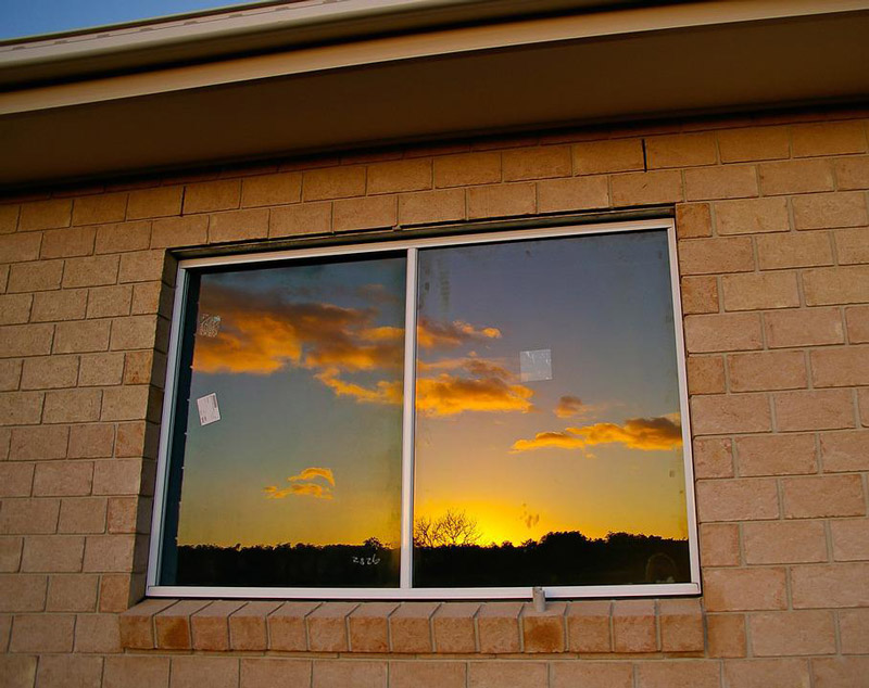 Sky sunset. Window reflection