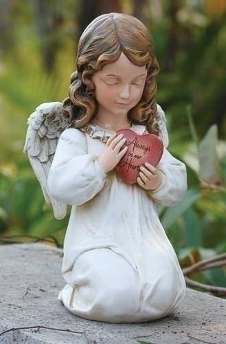 """Memorial Angel holding a heart that reads: """"Always in our Hearts"""". Resin Stone Mix, Dimensions: 11.75""""H x 6.25""""W x 6.88""""D"""