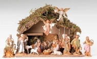 Nativity set with 15 figures and a stable made of wood, moss, bark, and polymer.