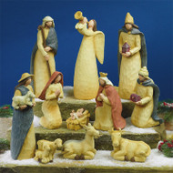 "Folk Art 11 piece Nativity Set~Folk Art Nativity Set-11 piece classic nativity pieces are crafted of resin with the look of carved wood and painted in soft hues.  Styrofoam packed in a brown box. Pieces measure approx. 2"" - 9 1/2""."