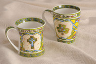 These one China Mugs depict a Shamrock and a High Celtic Cross in the style of 9th century ancient Celtic manuscripts which would have been painted by monks onto vellum or calf skin. Both Mugs are Microwave and Dishwasher safe.  A. Celtic Cross Mug-Hold 11 ounces or  B. Shamrock Mug- Holds 13 ounces