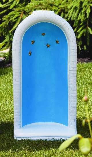 """This round grotto features star detailing around the top and comes in a detailed stain or natural color option. The detailed stain features a blue inside, gold stars, and a white trim. This grotto has a height of 34 inches and can fit a 26 inch statue inside.  Details:  34"""" H Base Width 17"""" Base length 13"""" Weight: 113 lbs Made to order Allow 4-6 weeks for delivery"""