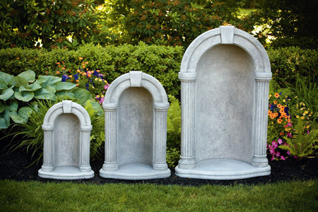 """Keystone grotto with detailed columns made of cast stone. This keystone grotto is made with cast stone and comes in three sizes and different color options. This is a beautifully designed grotto the offers and simple look.  The 26"""" grotto fits an 18"""" statue,. The 36"""" grotto fits a 26"""" statue.  The 52"""" grotto fit a 36"""" statue.  Choose natural cement or detailed stain for your color options.  Allow 3-4 weeks for delivery.  Made in USA"""