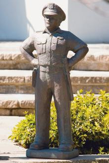 """42.5""""H Police Officer Cement Garden Statue. Weight: 128lbs. Dimensions: 42.5""""H x 12.5""""W x 11.5""""L. All statuary is custom made. Please allow  3-4 weeks for delivery."""
