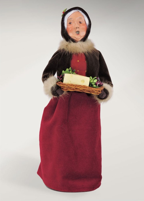 Mrs. Claus love to entertain during the holiday season. She is dressed in her finest coats trimmed with fur.