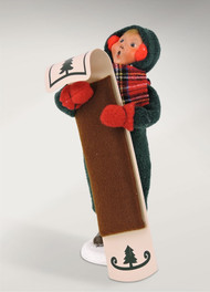 The Snow Day Kid with Toboggan is bundled up snug and tight and is ready to have some fun.