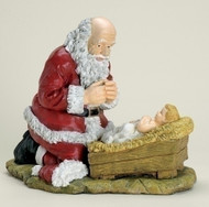 "Kneeling Santa with Child Jesus. Materials: Resin/Stone Mix. Dimensions:  12""H x 12""L"