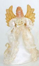 "10"" Angel's gown embroidered with gold and sequins. 10 miniature clear steady burning bulbs with white wire.  10""H x 5""W x 5""D ~ Material(s): fabric/porcelain/plastic/glass"