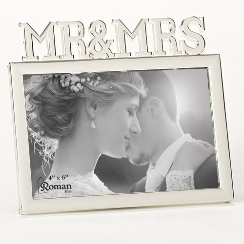 """From the Caroline Collection the rectangular frame holds a 4"""" x 6"""" photo. Made of zinc alloy. Lead free"""