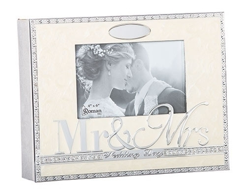 "From the Caroline Collection this beautiful wedding photo album holds 156 4"" x 6"" photographs. The album measures 8.5"" in hieght. Made of zinc alloy. Lead free"