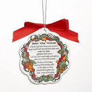 "Reverse Side: Suzy Toronto's  ""Three Wise Women"" Christmas Ornament. Comes with red bow and string for hanging on tree."
