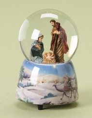 Snow globe with Holy family inside glass globe and a base that features the wise men following the Star of Bethlehem.