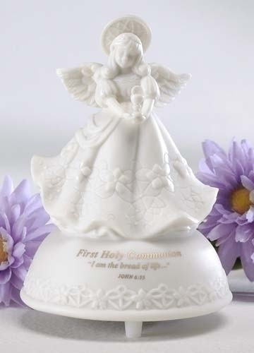 """5"""" First Holy Communion Musical Angel made of porcelain. Message says """"First Holy Communion - I am the bread of life..."""". Tune- The Lord's Prayer. Measurements: 5"""" height x 3.5"""" diameter. Gift Boxed."""