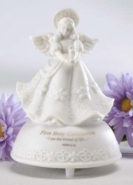 "5"" First Holy Communion Musical Angel made of porcelain. Message says ""First Holy Communion - I am the bread of life..."". Tune- The Lord's Prayer. Measurements: 5"" height x 3.5"" diameter. Gift Boxed."