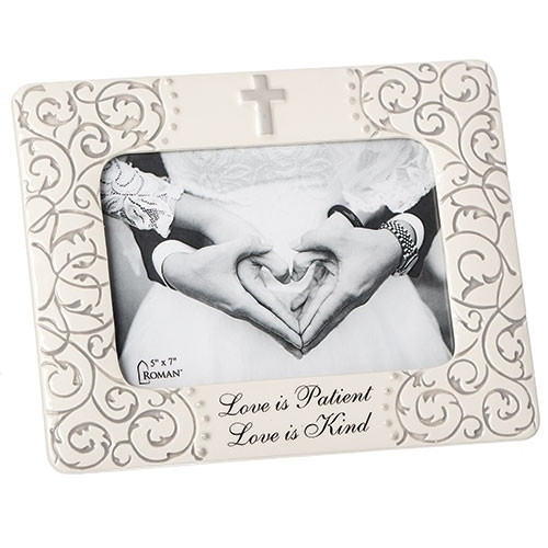 """7.75""""H Mr. & Mrs. Scroll Frame.  A simple cross adorns the top of the frame, while the bottom of the frame has the wording """"Love is Patient, Love is Kind"""" Scrolling adorns both sides of the frame. Perfect Wedding or Anniversary gift. Holds a 5' x 7"""" photo."""