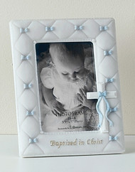 "7"" Baptism frame for a Boy or Girl, holds a 3.5"" X 5"" photo. Measures 7""H x 5.5""W x .5""D. Made of Resin/Stone Mix and Glass."