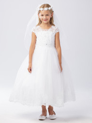 This communion dress has a lovely illusion neckline. The bodice of this dress is adorned with lace applique and rhinestones. The tulle skirt also has a lace applique hem.