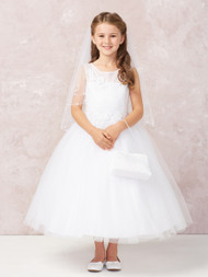 This gorgeous communion dress has an illusion neckline. The bodice has diagonal embroidery with lace accent.