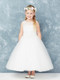 This gorgeous communion dress has an illusion neckline. The bodice has diagonal embroidery with lace accent. Sizes 8X and 10X