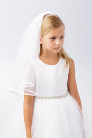 This simple Communion Headpiece has a thin border of white satin.