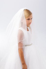 A crystal floral motif highlits this veil. Veil comes in White or Ivory.