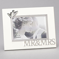 "7""H White Wedding or Anniversary Photo Frame adorned with decorative hearts and the words Mr. and Mrs. across bottom of the frame.  Frame holds 4"" x 6"" photo. Frame is made of sturdy medium density fiberboard."