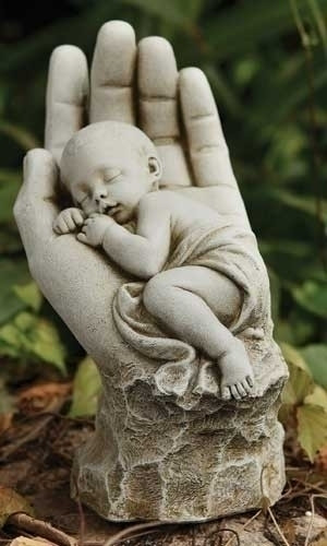 "In the Palm of His Hand Garden Statue.  Made of a resin/stone mix. Dimensions: 11.25""H x 5.75""W x 7.5""D"