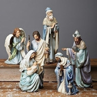 Nativity set with Holy family and the three kings in blue robes.