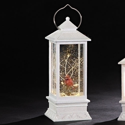 """11"""" LED White Swirl Lantern with Cardinal Ornament. Ornament is made of plastic and measures 10.88""""H. Battery operated. Batteries not included."""