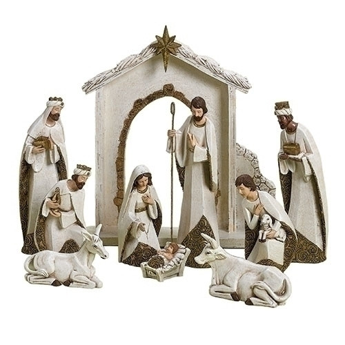 """10 Piece Ivory and Gold Nativity. Nativity has the Holy Family, the Three Wisemen, a donkey and an ox. The 12"""" Nativity is made of a resin/dolomite mix."""