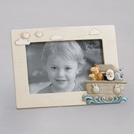 "5.75""H ""Noah's Ark"" photo frame.  The photo frame has a conglomerate of animals in the ark on the bottom right side of the Photo Frame. Frame is made of a resin stone mix. The 5.75"" photo frame holds a 4"" x 6"" photo."