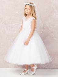 This Communion Dress has an illusion neckline.  The waistline of this communion dress is lace.