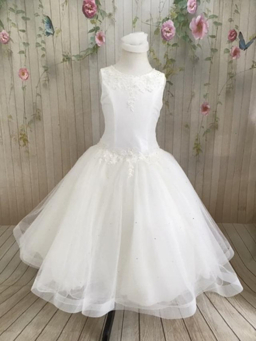 This dress is made with high-quality materials, including organza, French net, and bridal satin. The dress is embellished with embroidery, pearls, sequins, and crystals.  If you are looking for a simple, yet stunning First Holy Communion dress for your daughter, this is a great option. The simple style paired with the beautiful detailing creates a dress that your little one will absolutely love. Start shopping for your daughter or granddaughter's communion dress now! Details: Organza, French net, and satin Pearl and crystal detailing Buttons in back Multiple sizes Please call us at 1.800.523.7604 for verification of items in stock as they are selling quickly!