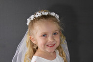Wreath and Veil has small silk flowers with rhinestone centers and pearl leaves