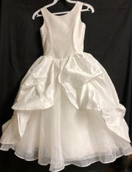 This dress is made with high-quality materials, including organza, French net, and bridal satin. If you are looking for a simple, yet stunning First Holy Communion dress for your daughter, this is a great option. The simple style paired with the beautiful detailing creates a dress that your little one will absolutely love. Start shopping for your daughter or granddaughter's communion dress now.  Please call us at 1.800.523.7604 for verification of items in stock as they are selling quickly!