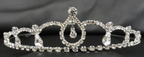 """The 1 1/2"""" high silver crown features sparkling clear rhinestones with a dangling rhinestone in the center of the tiara. A beautiful addition to any communion dress!"""