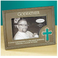 "Godfather Photo Frame. The Godfather Photo Frame has a cross on the bottom right side of frame. The words ""A daily inspiration, a lif-long blessing, forever, a guide to God"" is written across the bottom of the photo frame. Godfather Photo Frame measures 6.75""W x 5""H. This resin photo frame holds a 2.75"" x 4.5"" photo and has an easel backer for easy standing up."