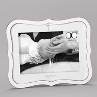 """White Baptismal Frame with Cross.  Baptismal Frame is made of a zinc alloy and is lead free.  The Baptism Frame with Cross is 8.25""""H. There is a cross at the top and the word Baptism across the bottom. The baptism frame holds a 4""""x 6"""" photo"""