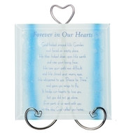 "Forever In Our Hearts Memorial Plaque with Stand. The Forever in Our Hearts Memorial Plaque measures 5.75"" x 4.75"".  The words on the bottom of the Memorial Plaque say ""God looked around His Garden and found an empty place. He then looked down upon His earth and saw your loving face. He saw your path was difficult and He closed your weary eyes. He whishpered to you ""Peace be Thine"" and gave you wings to fly. It broke our hearts to lose you, but you did not go alone. For part of us went with you on the day God called you home."" Made of beveled blue colored glass."
