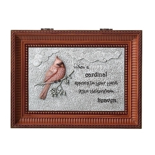 """Cardinal Bird Bereavement Music Box. Lid of the box has a Cardinal on a branch with the words """"When a cardinal appears in your yard it is a visitor from heaven."""" Music Box plays """"Nocturne"""".  Measurement: 3""""H x 6""""W x 8""""D. Made of Plastic and Metal"""