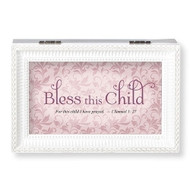 """Bless This Child White"" and Pink or Blue Music Box.  The lid has the words ""Bless this Child~For This Child I have Prayed.""  Music Box plays ""Jesus Loves Me."" Measurement: 6.125""L X 4""W X 2.625""H. Made of Plastic and Metal"