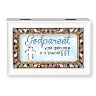 "White Jeweled Godparent Music Box   The lid has the words ""Godparent your guidance is a gift.""  Music Box plays ""What a Friend We Have in Jesus."" Measurement: 6.125""L X 4""W X 2.625""H. Made of Plastic and Metal"