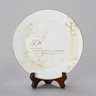 "Porcelain 9""H 50th Wedding Anniversary Plate. This 50th Wedding Anniversary Plate stands 9""H and had gold scrolling. Plate comes with a stand. ""Love does not look with the eyes, it sees with the heart. 50 years of marriage and a lifetime of love. Happy Anniversary"" is written on the white and gold plate. Measurements are: 9.25""H 9.25""W 1""D."