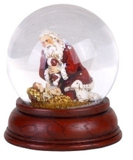 "Kneeling Santa Dome.  Dimensions: 4.75""H. Made of Glass, Water, and Metal."