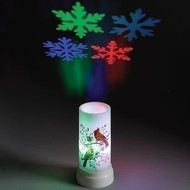 """Celebrate the Season with this 6.75""""H LED Snowflakes Projector Candle with USB Cord. Measurements are 6.75""""H x 3.625Dia.  LED Snowflakes Projector Candle is made of plastic. Batteries not included."""